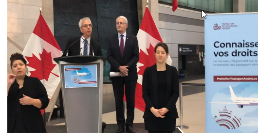 Scott Streiner, Canadian Transportation Agency Chair and CEO, and The Honourable Marc Garneau, Minister of Transport with sign language interpreters at the Ottawa International Airport, December 13, 2019